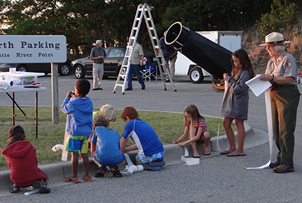 Young visitors record their observations at a Night Sky event at Sleeping Bear Dunes National Lakeshore.