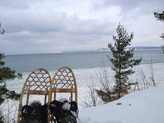 View of Platte Bay in winter with snowshoes in foreground