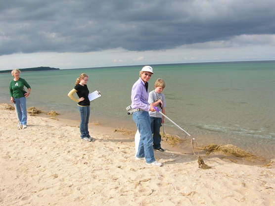 Park volunteers clean up their adopted beach in the National Lakeshore. Photo courtesy of National Park Service.