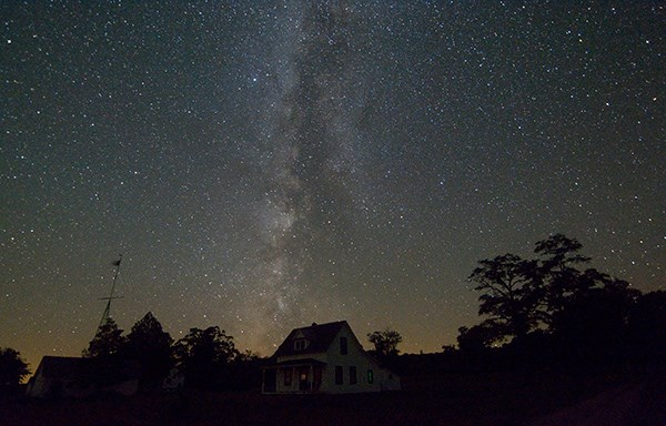 The Milky Way glows over North Manitou Island viilage