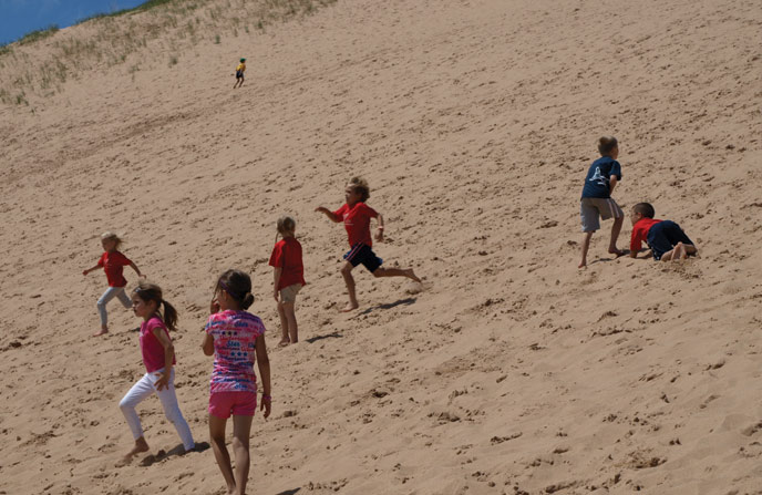 Kids running down the Dune Climb