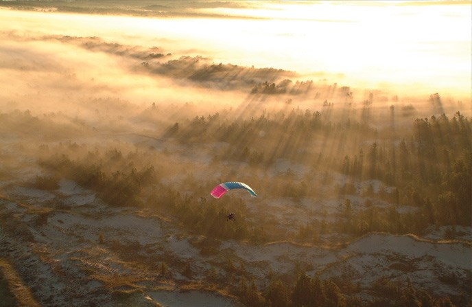 paragliding over Lake Michigan shoreline