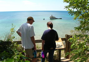 Hikers looking at Morazan shipwreck on SMI