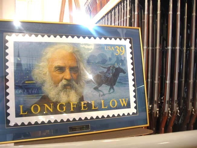 Image of Longfellow postage stamp next to the musket rack