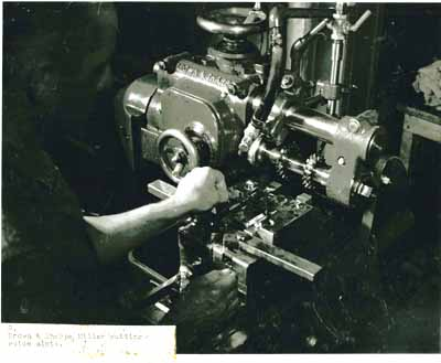 Here may be seen a Brown & Sharpe milling machine with two cutters for