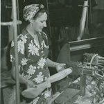 A Woman Ordnance Worker makes a gun stock at Springfield Armory during World War II