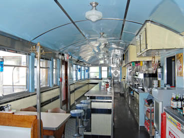 Classic Looking Large Diner. Blue Stools and Off-White Countertop