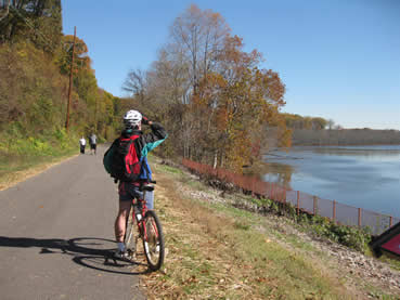 Bicyclist views Mattawoman Creek from Indian Head Rail Trail
