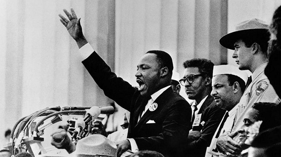 Black-and-white image of Dr Martin Luther King, Jr addressing the March on Washington civil rights supporters from the steps of the Lincoln Memorial