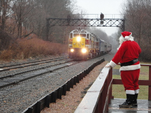 "Santa waits along a wooden train platform at Moscow Station for arriving Steamtown NHS ""Holiday Express"" train"
