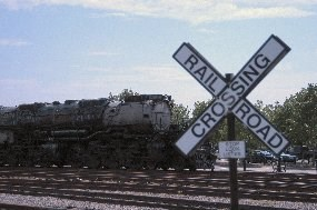 Photo of railroad crossbucks.  The white X with
