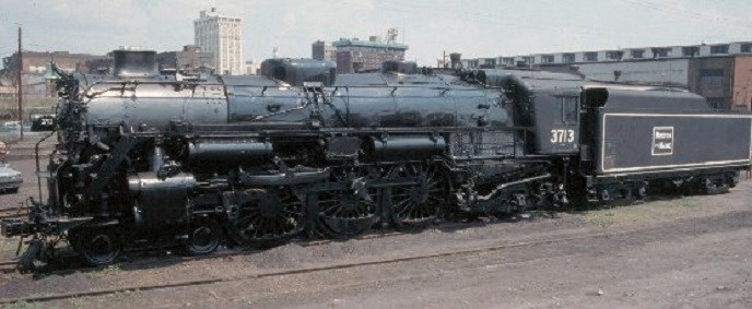 Boston & Maine #3713 on display pre-1995 is painted mostly in black, except for white stripe trim and a graphite-gray smokebox on the front.