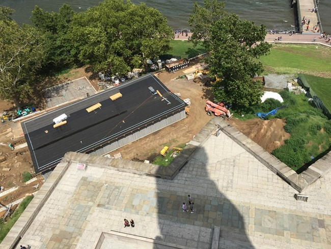 A photo of the construction happening for the new screening site taken from the top of the pedestal.