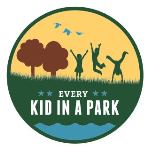 Every Kid in a Park logo: graphic of three children playing in natural setting of grass, trees, birds, and water.