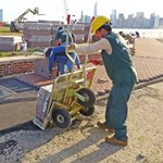 Workers restore walkway in front of the Statue of Liberty.