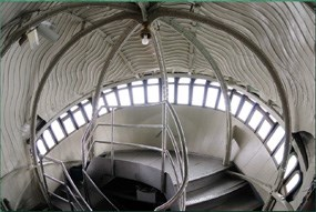 Photo from the interior of the Statue of Liberty's head looking down the spiral staircase.