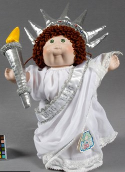 Cabbage Patch doll in white gown and silver crown c. 1986
