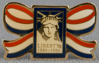 Brass pin, painted red, white and blue, with Statue of Liberty-Ellis Island Foundation logo, 1986