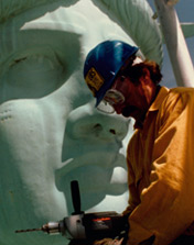 A worker near the Statue's face during restoration circa 1984.