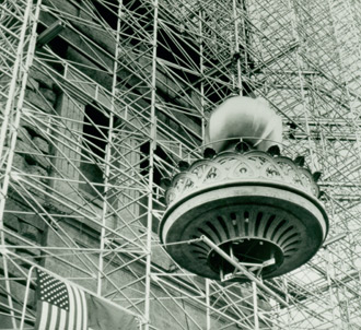 The new torch being lifted into place during restoration circa 1985.
