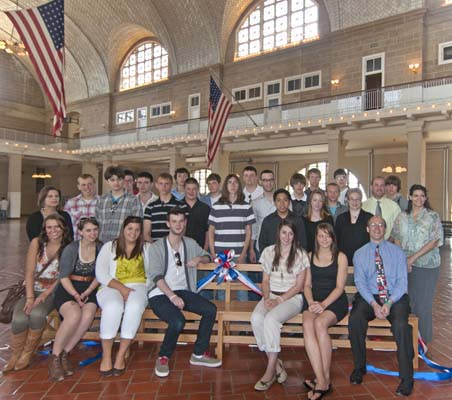 Students from Campbell-Savona High Schools take a seat in history as they presented two new benches to Ellis Island as part of a NPS Distance Learning program.