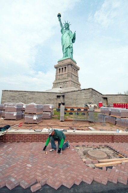 A contractor rebuilds the walkway on Liberty Island.
