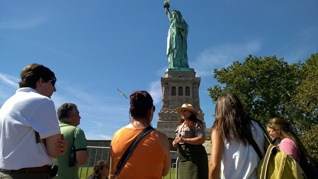 A ranger gives a tour at the front of Liberty Island.