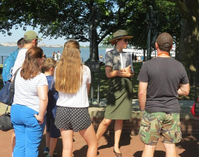 A park ranger gives a tour on Liberty Island.