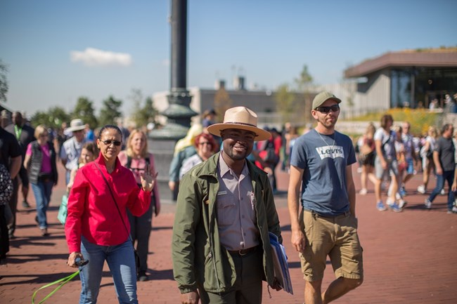 A park ranger guides a tour on Liberty Island