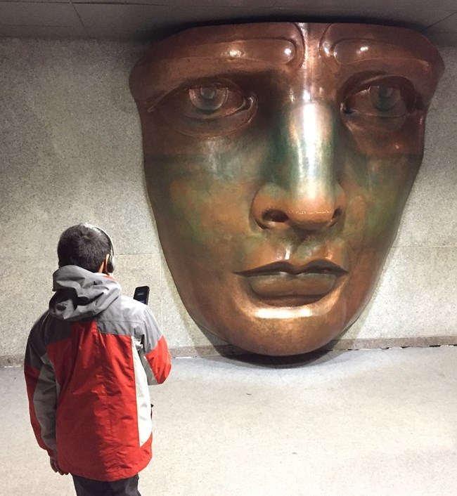 A young visitor in the Statue's museum with a audio tour