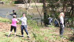 Volunteers clear invasive exotic plants from the bank of Lytle Creek.