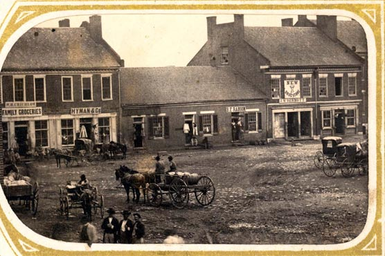 Historic photo showing wagons and stores on the Murfreesboro square.