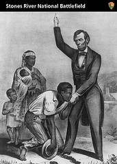 Historic drawing of freed slaves and President Abraham Lincoln.