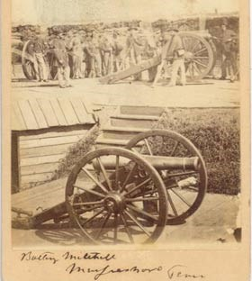 Historic photograph of soldiers and cannon in Battery Mitchell of Fortress Rosecrans