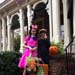 Trick or treaters stand in front of Oaklands Historic House Museum.