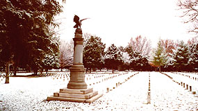 U.S. Regulars Monument in snow covered cemetery.