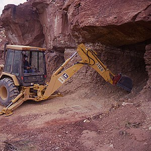 tractor filling mine opening