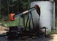 pump jack and large tank