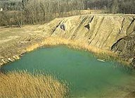gravel pit with water covering the bottom