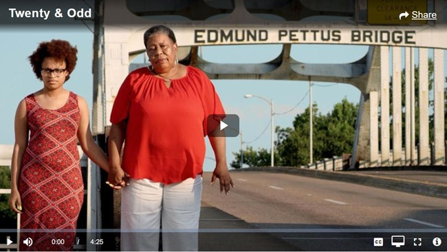 in a thumbnail video image, two women stand in front of the Edmund Pettus Bridge