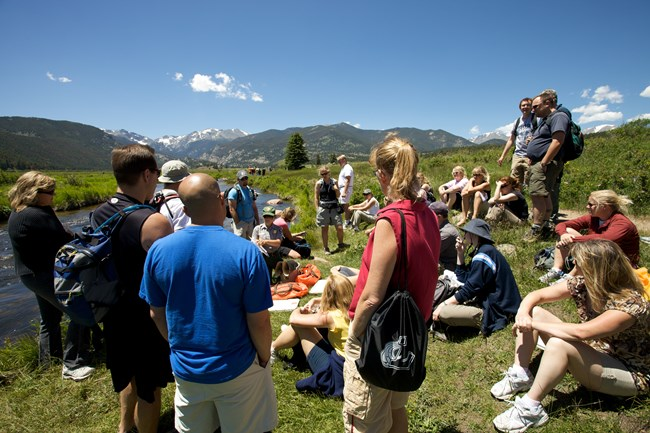Photograph of students listening to a NPS air resources division presenter during a field trip to Rocky Mountain NP, Colorado.