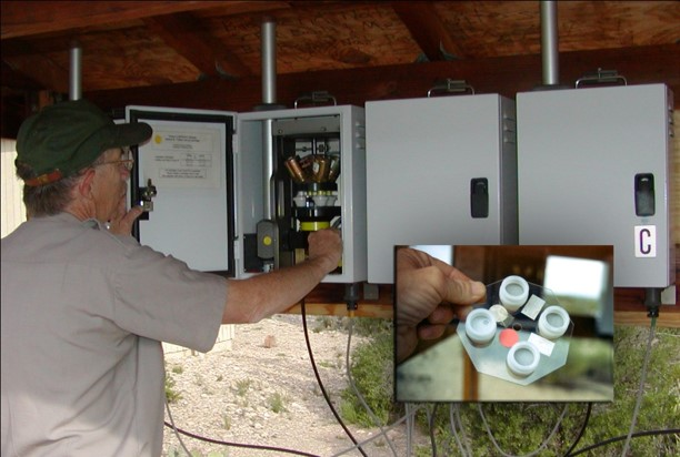 An NPS employee changes the visibility monitoring filter packs at an IMPROVE monitoring station