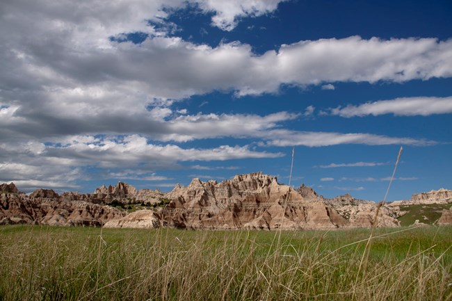 Grass prairie and rock formations in Badlands National Park