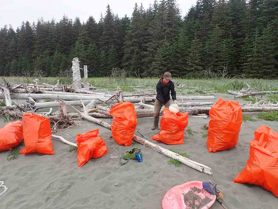 Large bags of marine debris collected at a beach near Yakutat