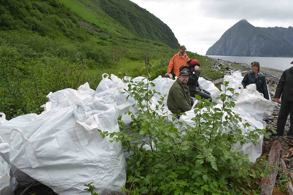 A marine debris clean up crew waits for pick up