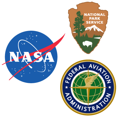 A blue NASA logo, brown NPS arrowhead and blue and gold FAA logo