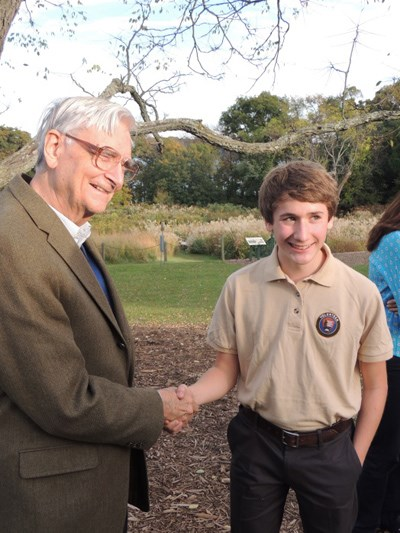 Ben shaking E.O. Wilson's hand and smiling