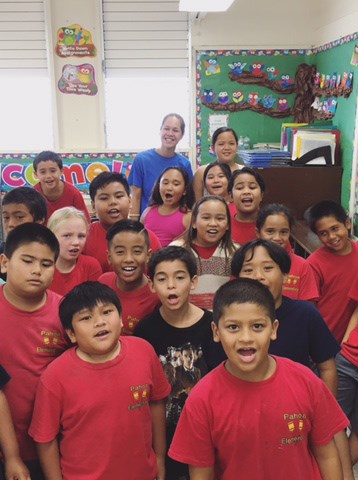 Julia with a classroom of children