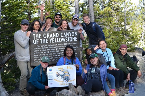 "Park with other 3D Naturalists in front of a sign reading ""The Grand Canyon of the Yellowstone"""