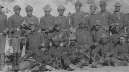 Several soldiers posing for a group portrait